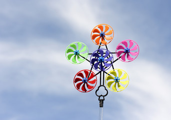 Colorful pinwheel against blue sky