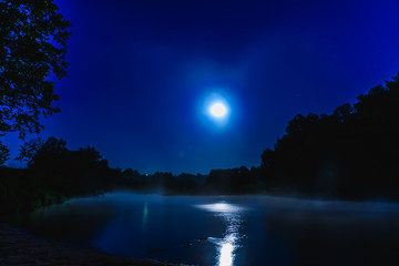 river at night with fog