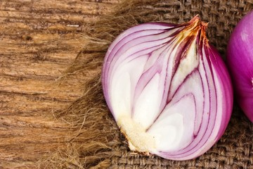 Red onion on sack and on wood
