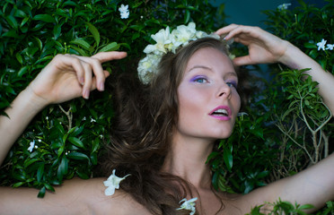 Girl in flowers with floral wreath