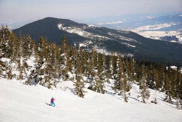 WInter ski resort snow mountains landscape with blue sky