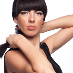 Young brunette hair holding a black dress on a white background