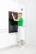 woman press button modern kitchen appliance
