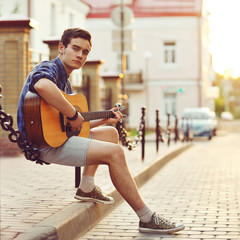 Handsome young man with guitar