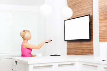 woman watching tv hold remote control