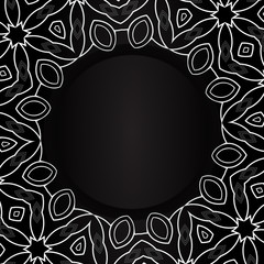 Black circle with silvery ornaments