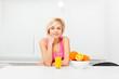 woman orange juice drink glass in her kitchen