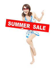 happy bikini girl holding a sign of  summer sale.
