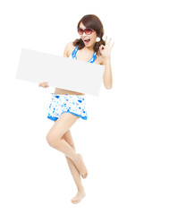 happy sunshine woman holding a board and ok gesture