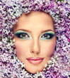 Beautiful fashionable portrait , model of flowers lilac .