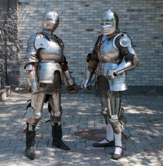two knights in the ancient metal armor