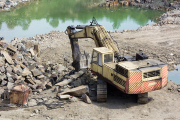 Excavator machine doing earthmoving work