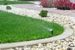 Sprinklers watering grass - 66227346