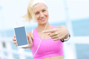 Young woman showin phone