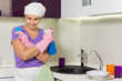 Lady holding spray cleaner and kitchen sponge