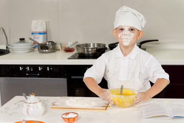 Young chef with flour on his face