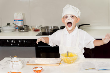 Young boy having fun in the kitchen