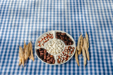 plate dried beans mix pod on checked tablecloth