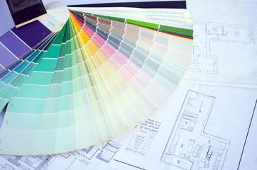 color palette samples lie on house design drawings