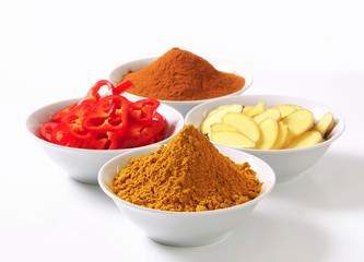 Curry powder, ground cinnamon, sliced ginger root and red pepper