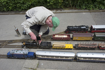 Model railway engineer servicing his locomotives