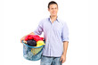 Man holding a laundry basket full of clothes