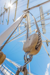 Wooden pulley on an old yacht vertical.