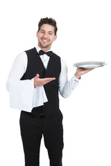 Confident Young Waiter With Napkin And Serving Tray