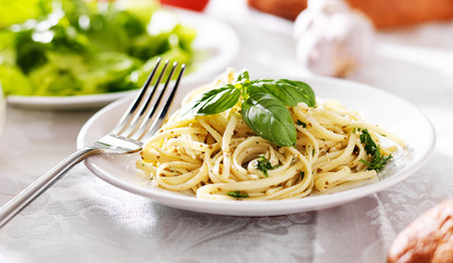 pesto sauce on italian spaghetti pasta