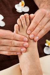 Therapist Giving Foot Massage To Female Customer At Spa
