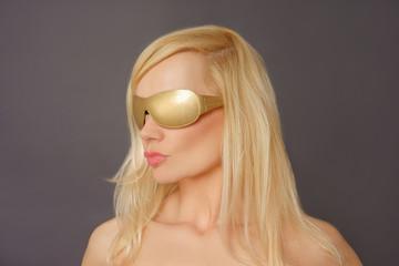 Blonde Model Wearing Golden Sunglasses