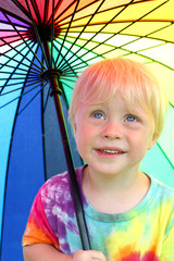 Little Child Under Rainbow Rain Umbrella