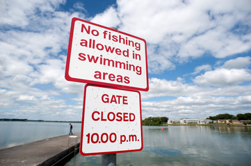 no fishing allowed in swimming area sign