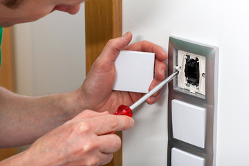 Man fixing the light switch