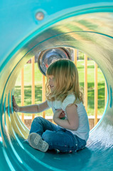 Little girl in play tube