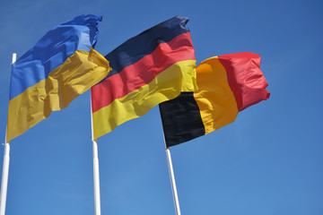 Flags of Ukraine, German, and Belgium