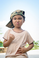 Asian kid with soldier cap