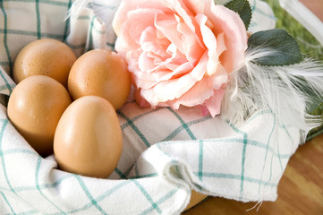 uncooked eggs in basket