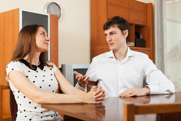 couple having serious talking at table