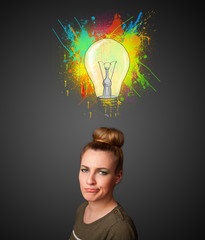Young woman thinking with lightbulb above her head