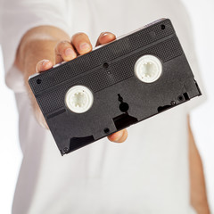 VHS cassette hold by hand