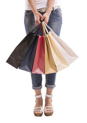 Low section of woman with multi-colored shopping bags
