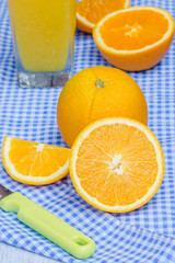 Oranges cut set and orange juice on table
