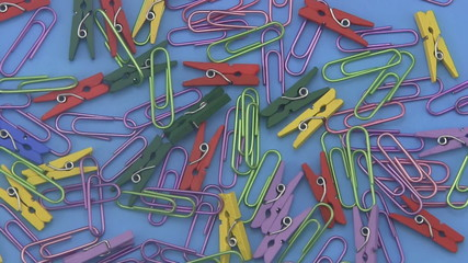 Assorted coloured  paper clips.