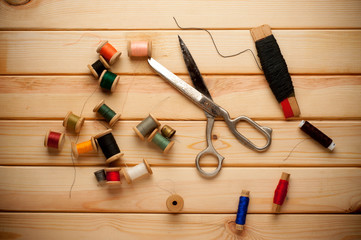 Vintage Background with sewing tools and on the wooden