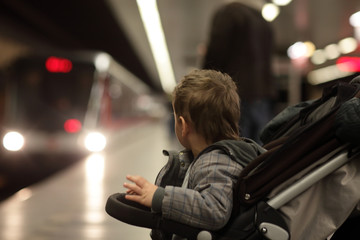 Child looking at train