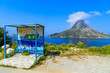 colorful bus stop with the island in the background