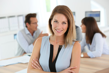 Portrait of beautiful woman attending business meeting