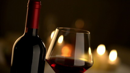 Red wine tasting at restaurant with candlelight on background.