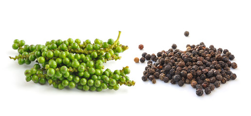 Bunches of fresh green pepper and Black peppercorn isolated on w